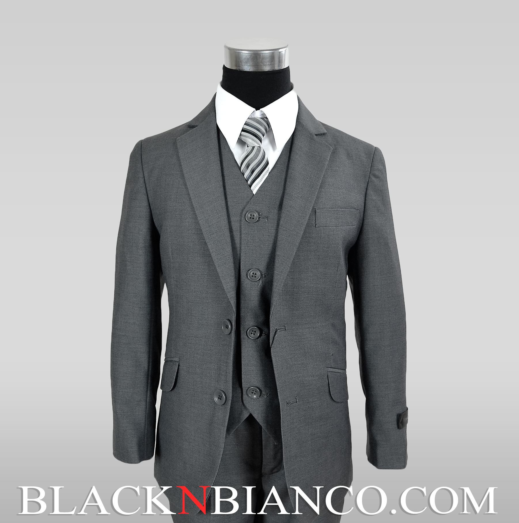 This medium grey kids suit comes in sizes 4 - 20 and is crafted by AFT. It is also a five piece suit offering, a white dress shirt with lay down collar, matching vest, dress tie, and the two button jacket.
